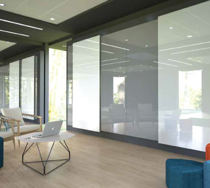 Floor to ceiling dry erase sliding glassboards integrated into wall systems.