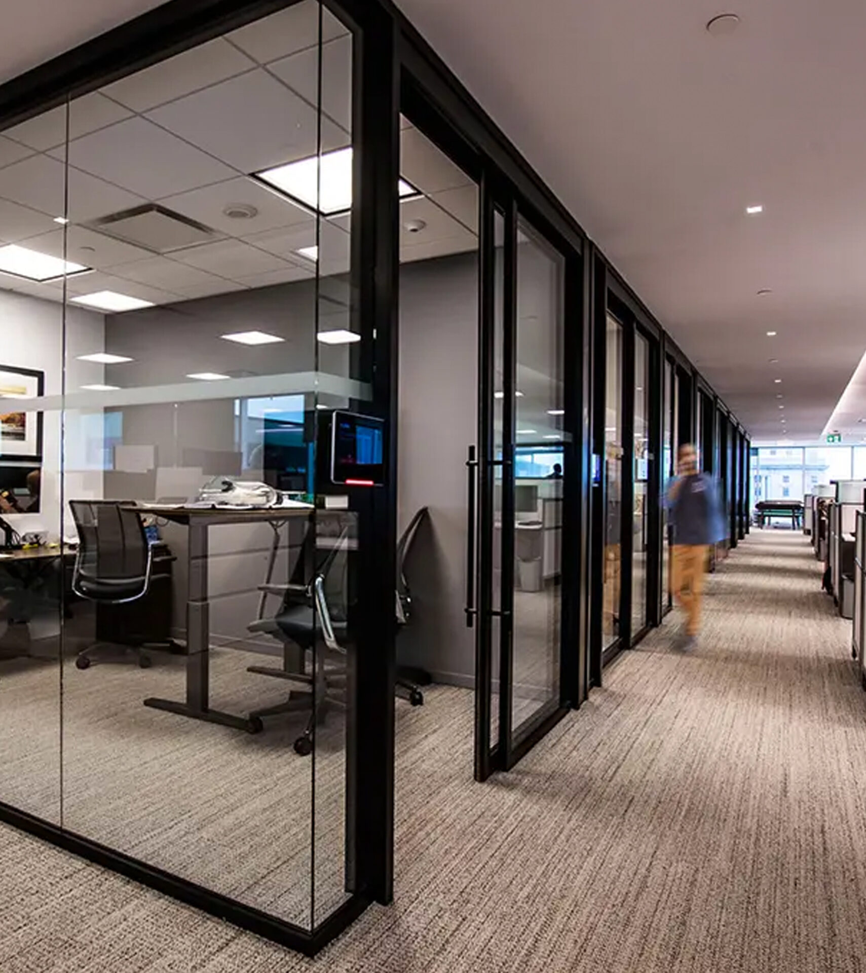 Starwall integrated glass wall systems shown in center-mount glass in black frame with frameless butt-joint glass.
