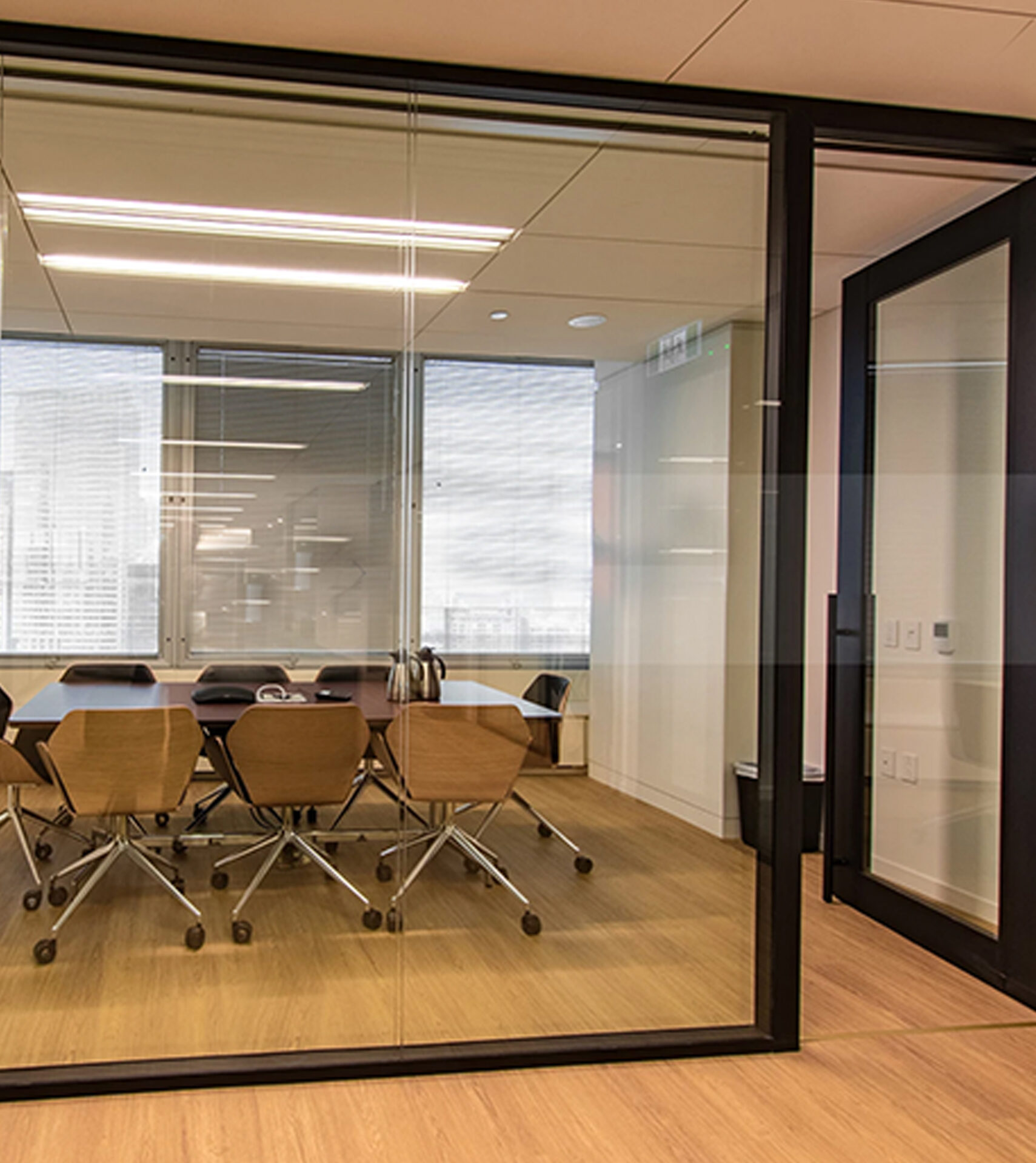 Starwall integrated glass wall systems shown in center-mount glass in black frame.